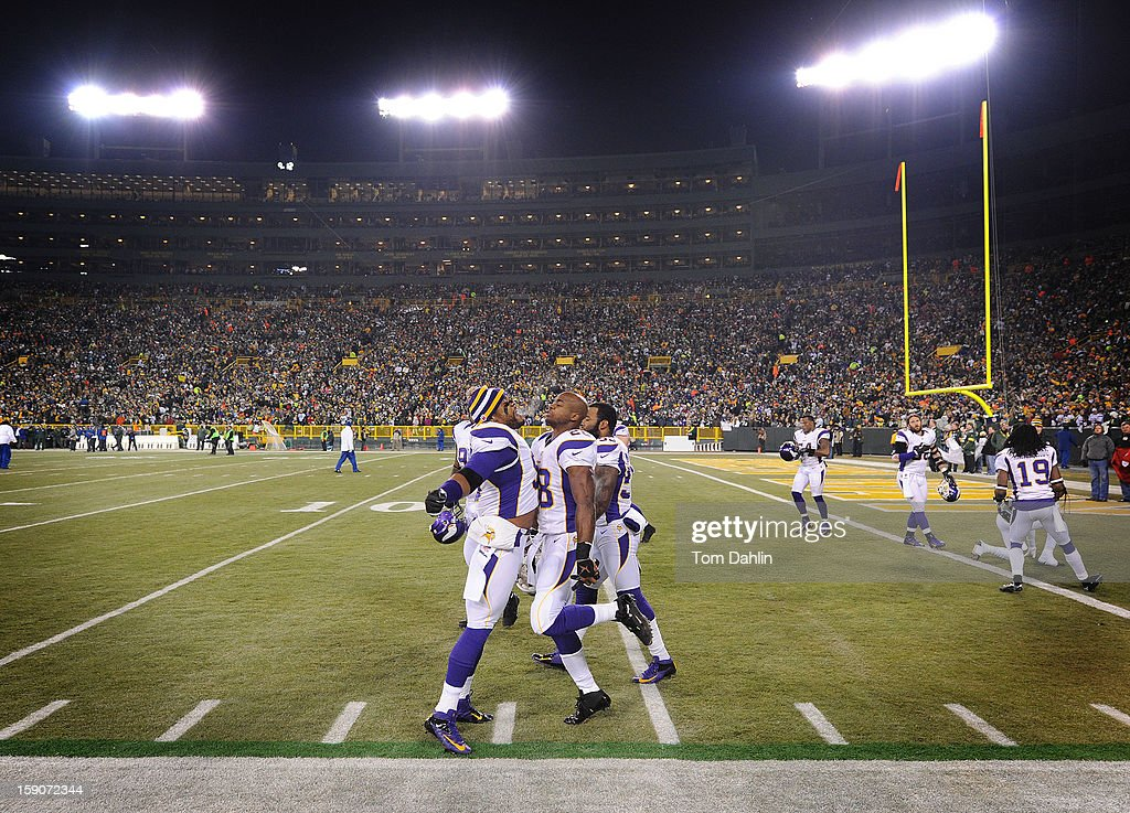 Adrian Peterson #28 and Everson Griffen #97 of the Minnesota Vikings chest bump prior to an NFL game against the Green Bay Packers at Lambeau Field, January 5, 2013 in Green Bay, Wisconsin.
