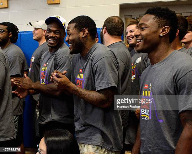 Adrian Peterson Mike Wallace and Stefon Diggs of the Minnesota Vikings smile after the ribbon cutting ceremony during the 10th Annual Minnesota...
