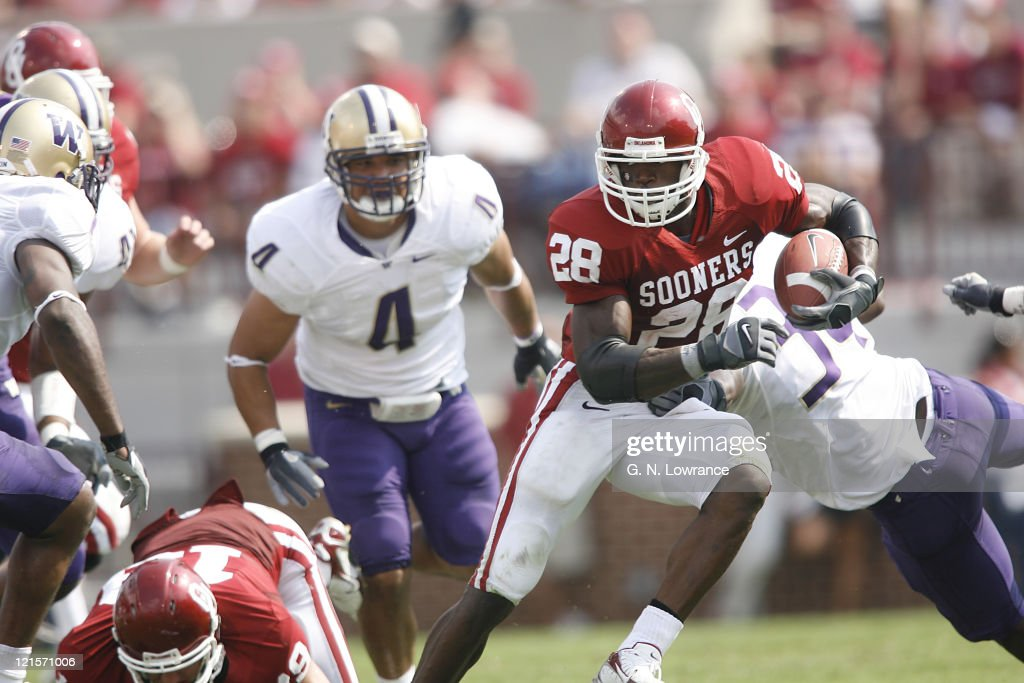 Adrian Peterson of Oklahoma looks for an opening during action between the Washington Huskies and Oklahoma Sooners at Owen Field in Norman Oklahoma...