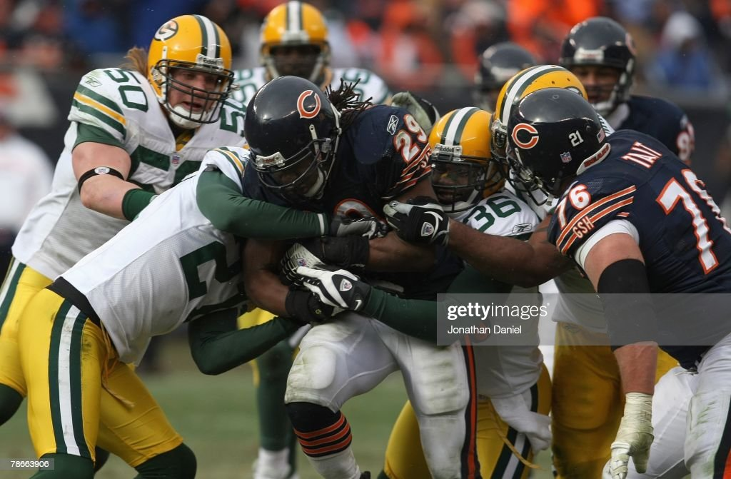 Adrian Peterson #29 of the Chicago Bears fights for yards against the Green Bay Packers on December 23, 2007 at Soldier Field in Chicago, Illinois.