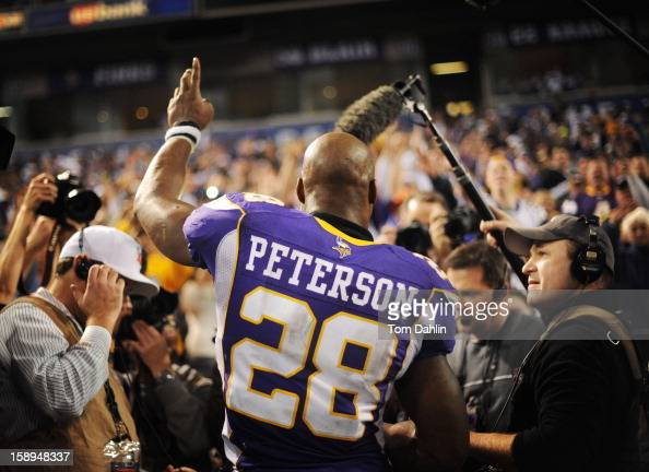 Adrian Peterson of the Minnesota Vikings acknowledges fans after an NFL game against the Green Bay Packers at the Hubert H Humphrey Metrodome on...