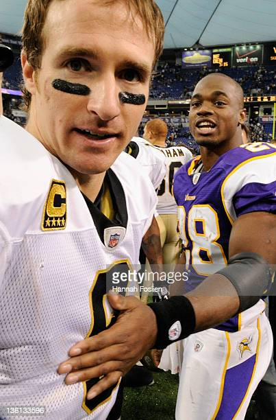 Adrian Peterson of the Minnesota Vikings and Drew Brees of the New Orleans Saints speak following the game on December 18 2011 at Mall of America...