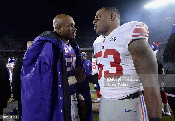 Adrian Peterson of the Minnesota Vikings and Jasper Brinkley of the New York Giants speak after the game on December 27 2015 at TCF Bank Stadium in...