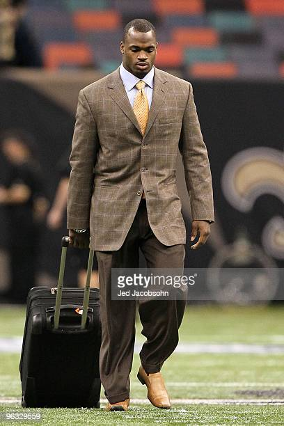 Adrian Peterson of the Minnesota Vikings arrives at the dome to play against the New Orleans Saints during the NFC Championship Game at the Louisiana...