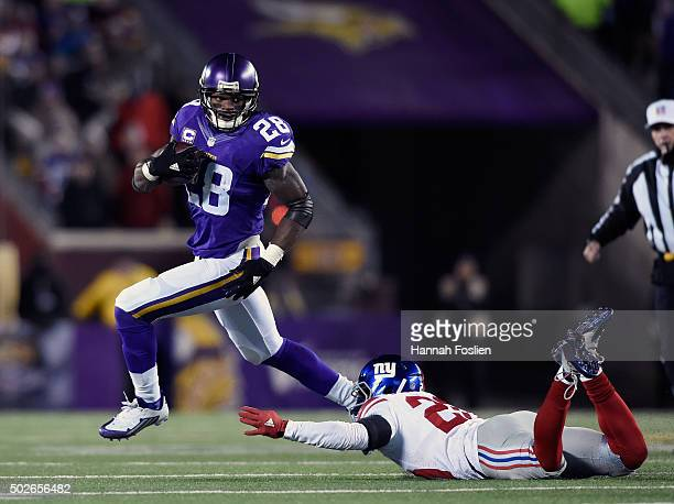 Adrian Peterson of the Minnesota Vikings avoids a tackle by Prince Amukamara of the New York Giants during the second quarter of the game on December...