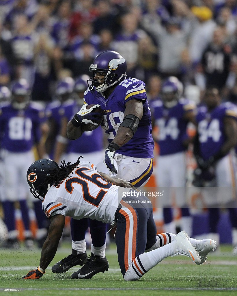<a gi-track='captionPersonalityLinkClicked' href=/galleries/search?phrase=Adrian+Peterson+-+American+Football+Player+-+Minnesota+Vikings&family=editorial&specificpeople=210807 ng-click='$event.stopPropagation()'>Adrian Peterson</a> #28 of the Minnesota Vikings avoids a tackle by <a gi-track='captionPersonalityLinkClicked' href=/galleries/search?phrase=Tim+Jennings&family=editorial&specificpeople=2081449 ng-click='$event.stopPropagation()'>Tim Jennings</a> #26 of the Chicago Bears during the fourth quarter of the game on December 1, 2013 at Mall of America Field at the Hubert H. Humphrey Metrodome in Minneapolis, Minnesota. Peterson went over 10,000 career rushing yards on the play. The Vikings defeated the Bear 23-20 in overtime.