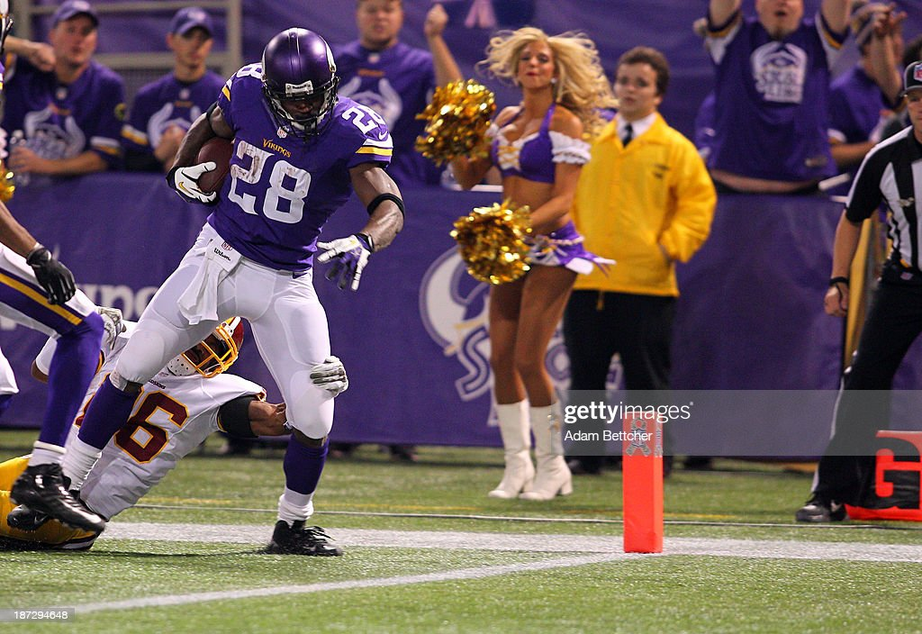Adrian Peterson #28 of the Minnesota Vikings breaks free from the tackle of Josh Wilson #26 of the Washington Redskins for a touchdown on November 7, 2013 at Mall of America Field at the Hubert Humphrey Metrodome in Minneapolis, Minnesota.