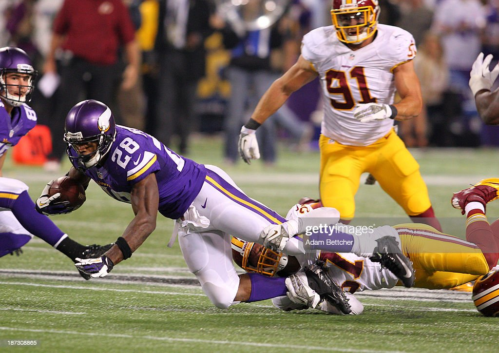 <a gi-track='captionPersonalityLinkClicked' href=/galleries/search?phrase=Adrian+Peterson+-+American+Football+Player+-+Minnesota+Vikings&family=editorial&specificpeople=210807 ng-click='$event.stopPropagation()'>Adrian Peterson</a> #28 of the Minnesota Vikings breaks free from the tackle of <a gi-track='captionPersonalityLinkClicked' href=/galleries/search?phrase=Nick+Sundberg&family=editorial&specificpeople=4155038 ng-click='$event.stopPropagation()'>Nick Sundberg</a> #57 of the Washington Redskins on November 7, 2013 at Mall of America Field at the Hubert Humphrey Metrodome in Minneapolis, Minnesota.