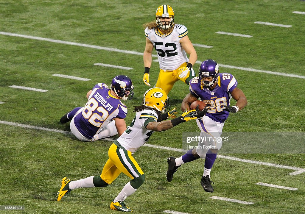 Adrian Peterson #28 of the Minnesota Vikings carries the ball against Morgan Burnett #42 of the Green Bay Packers during the first quarter of the game on December 30, 2012 at Mall of America Field at the Hubert H. Humphrey Metrodome in Minneapolis, Minnesota.