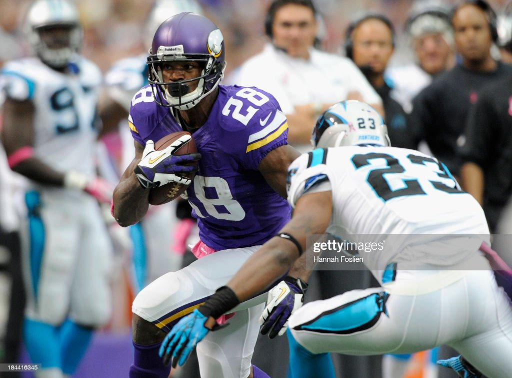 <a gi-track='captionPersonalityLinkClicked' href=/galleries/search?phrase=Adrian+Peterson+-+American+Football+Player+-+Minnesota+Vikings&family=editorial&specificpeople=210807 ng-click='$event.stopPropagation()'>Adrian Peterson</a> #28 of the Minnesota Vikings carries the ball against Melvin White #23 of the Carolina Panthers during the second quarter of the game on October 13, 2013 at Mall of America Field at the Hubert H. Humphrey Metrodome in Minneapolis, Minnesota. The Panthers defeated the Vikings 35-10.