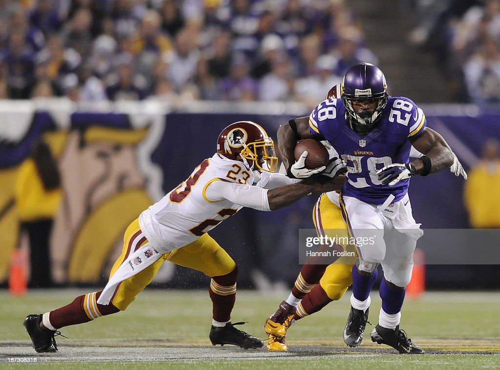 Adrian Peterson #28 of the Minnesota Vikings carries the ball against DeAngelo Hall #23 of the Washington Redskins during the fourth quarter of the game on November 7, 2013 at Mall of America Field at the Hubert H. Humphrey Metrodome in Minneapolis, Minnesota. The Vikings defeated the Redskins 34-27.