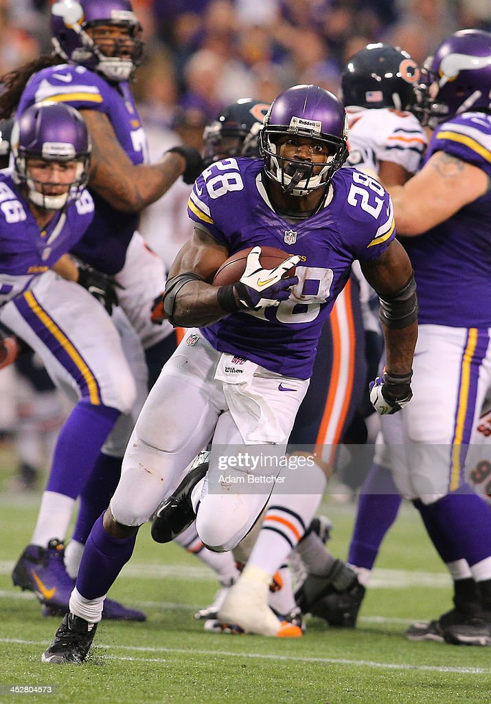 <a gi-track='captionPersonalityLinkClicked' href=/galleries/search?phrase=Adrian+Peterson+-+American+Football+Player+-+Minnesota+Vikings&family=editorial&specificpeople=210807 ng-click='$event.stopPropagation()'>Adrian Peterson</a> #28 of the Minnesota Vikings carries the ball against Chicago Bears on December 1, 2013 at Mall of America Field at the Hubert Humphrey Metrodome in Minneapolis, Minnesota.
