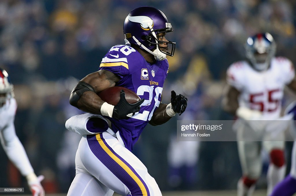 Adrian Peterson #28 of the Minnesota Vikings carries the ball against the New York Giants during the first quarter of the game on December 27, 2015 at TCF Bank Stadium in Minneapolis, Minnesota.