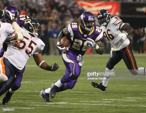 Adrian Peterson of the Minnesota Vikings carries the ball against the Chicago Bears at the Hubert H Humphrey Metrodome on December 17 2007 in...