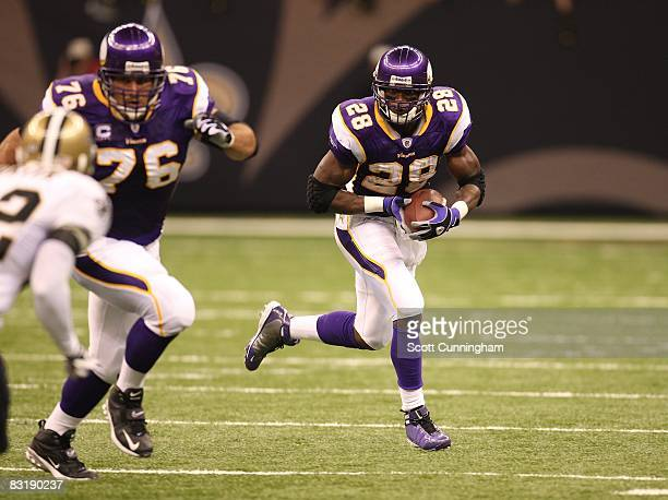 Adrian Peterson of the Minnesota Vikings carries the ball against the New Orleans Saints at the Louisiana Superdome on October 6 2008 in New Orleans...
