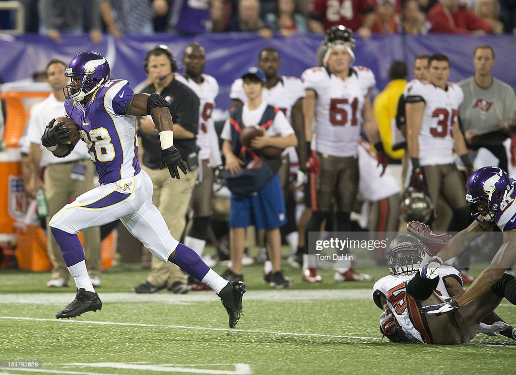 Adrian Peterson #28 of the Minnesota Vikings carries the ball during an NFL game against the Tampa Bay Buccaneers at Mall of America Field at the Hubert H. Humphrey Metrodome on October 25, 2012 in Minneapolis, Minnesota.