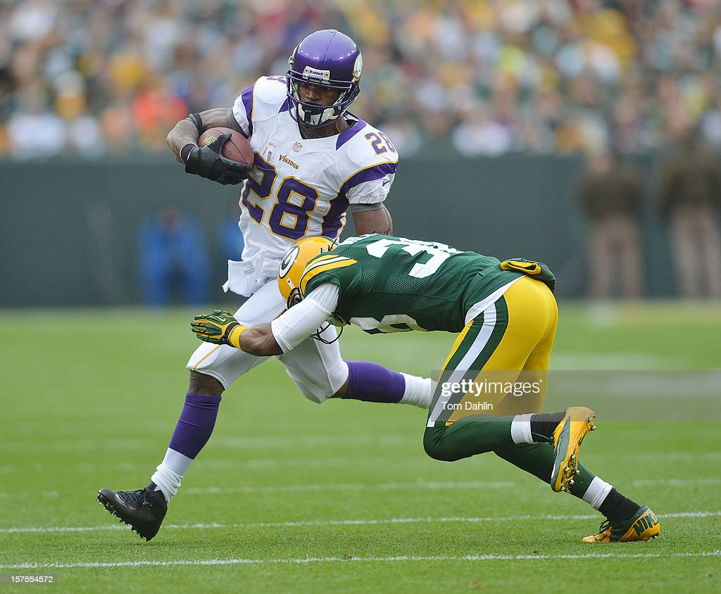 Adrian Peterson #28 of the Minnesota Vikings carries the ball during an NFL game against the Green Bay Packers at Lambeau Field on December 2, 2012 in Green Bay, Wisconsin.