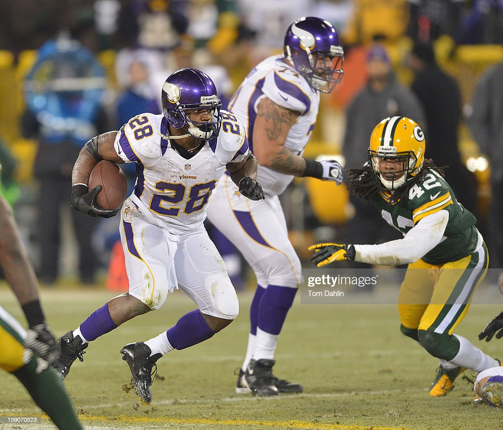 Adrian Peterson #28 of the Minnesota Vikings carries the ball during an NFL game against the Green Bay Packers at Lambeau Field, January 5, 2013 in Green Bay, Wisconsin.