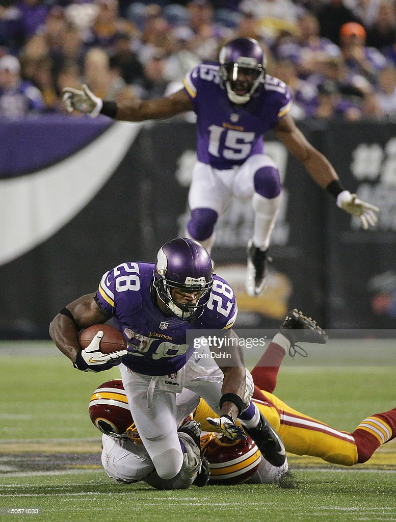 Adrian Peterson #28 of the Minnesota Vikings carries the ball during an NFL game against the Washington Redskins at Mall of America Field, on November 7, 2013 in Minneapolis, Minnesota.