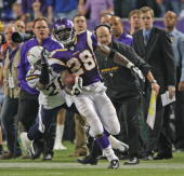 Adrian Peterson of the Minnesota Vikings carries the ball during an NFL game against the San Diego Chargers at the Hubert H Humphrey Metrodome...