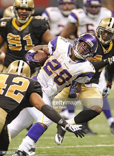 Adrian Peterson of the Minnesota Vikings carries the ball during the NFC Championship Game against the New Orleans Saints on January 24 2010 in New...