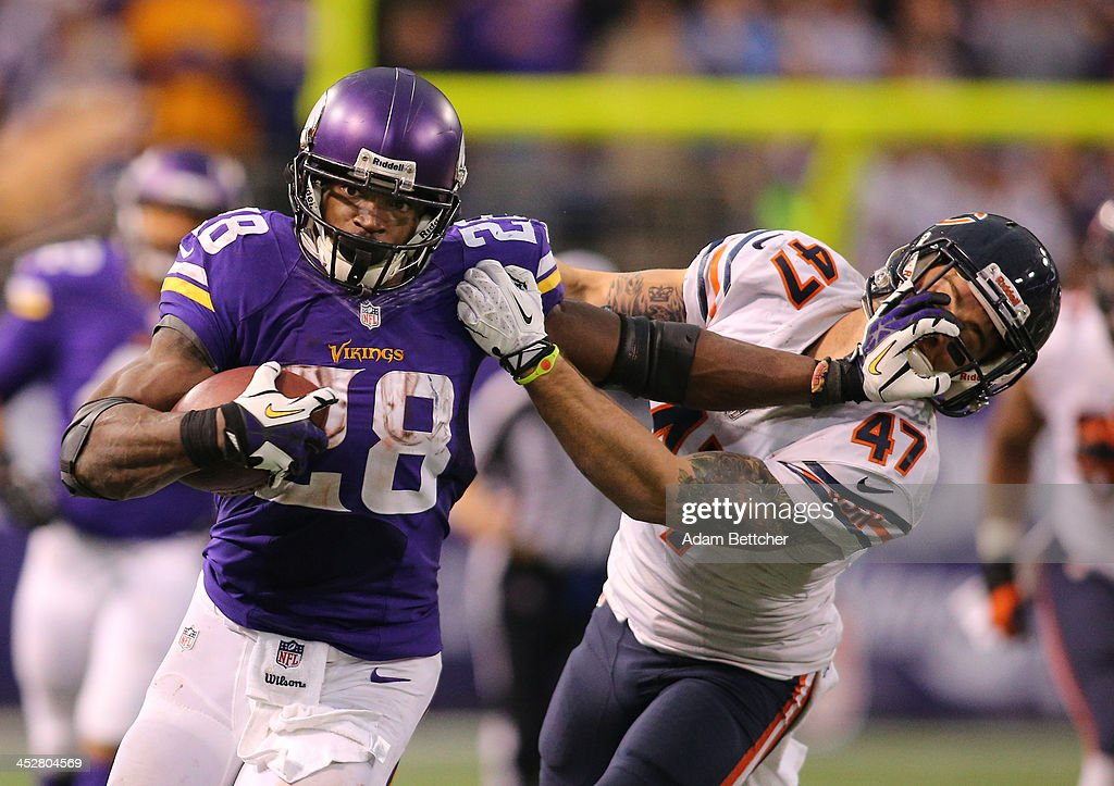 Adrian Peterson #28 of the Minnesota Vikings carries the ball for ten thousand career rushing yards against <a gi-track='captionPersonalityLinkClicked' href=/galleries/search?phrase=Chris+Conte&family=editorial&specificpeople=4524090 ng-click='$event.stopPropagation()'>Chris Conte</a> #47 of the Chicago Bears on December 1, 2013 at Mall of America Field at the Hubert Humphrey Metrodome in Minneapolis, Minnesota.