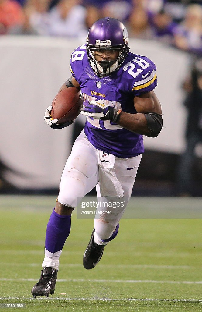 <a gi-track='captionPersonalityLinkClicked' href=/galleries/search?phrase=Adrian+Peterson+-+American+Football+Player+-+Minnesota+Vikings&family=editorial&specificpeople=210807 ng-click='$event.stopPropagation()'>Adrian Peterson</a> #28 of the Minnesota Vikings carries the ball for ten thousand career rushing yards against Chicago Bears on December 1, 2013 at Mall of America Field at the Hubert Humphrey Metrodome in Minneapolis, Minnesota.