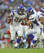 Adrian Peterson of the Minnesota Vikings carries the ball in an NFL game against the Arizona Cardinals on December 14 2008 at the University of...