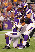 Adrian Peterson of the Minnesota Vikings celebrates a touchdown in the second quarter against the Jacksonville Jaguars during NFL opening day...