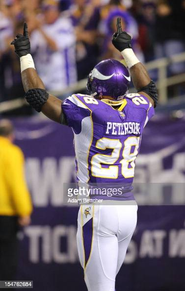 Adrian Peterson of the Minnesota Vikings celebrates a touchdown against the Tampa Bay Buccaneers at the Hubert H Humphrey Metrodome on October 25...