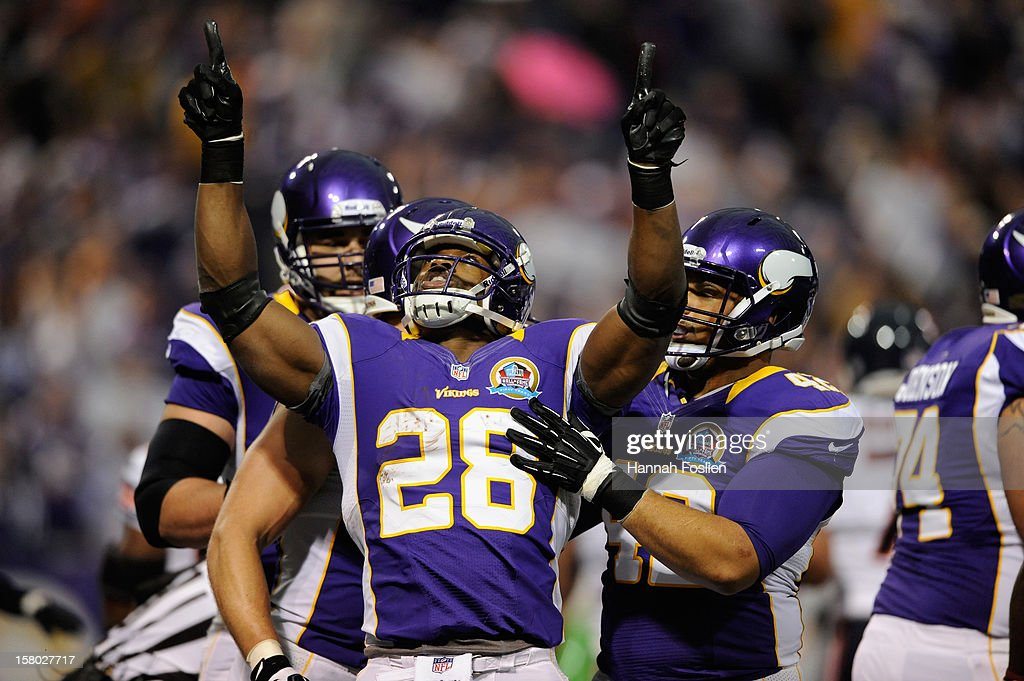 Adrian Peterson #28 of the Minnesota Vikings celebrates a touchdown during the first quarter of the game against the Chicago Bears on December 9, 2012 at Mall of America Field at the Hubert H. Humphrey Metrodome in Minneapolis, Minnesota.