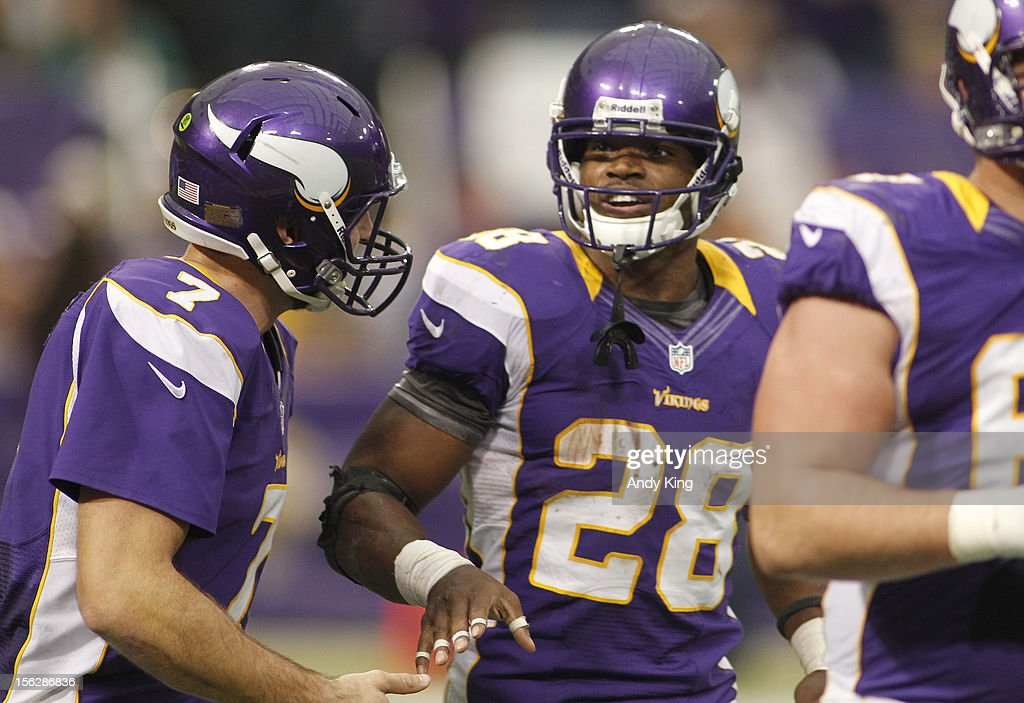 Adrian Peterson #28 of the Minnesota Vikings celebrates a touchdown with Christian Ponder #7 on November 11, 2012 at Mall of America Field at the Hubert H. Humphrey Metrodome in Minneapolis, Minnesota.