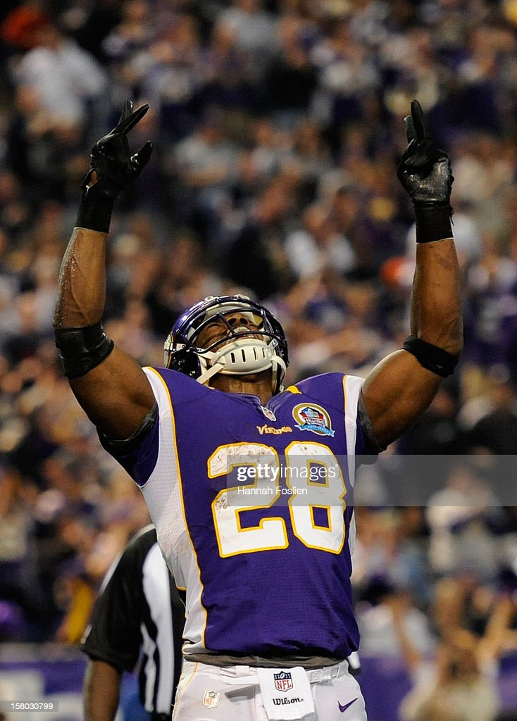 Adrian Peterson #28 of the Minnesota Vikings celebrates his second touchdown in the first quarter of the game against the Chicago Bears on December 9, 2012 at Mall of America Field at the Hubert H. Humphrey Metrodome in Minneapolis, Minnesota. The Vikings defeated the Bears 21-14.
