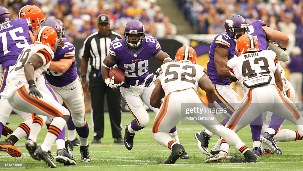 <a gi-track='captionPersonalityLinkClicked' href=/galleries/search?phrase=Adrian+Peterson+-+American+Football+Player+-+Minnesota+Vikings&family=editorial&specificpeople=210807 ng-click='$event.stopPropagation()'>Adrian Peterson</a> #28 of the Minnesota Vikings finds a hole against the Cleveland Browns on September 22, 2013 at Mall of America Field at the Hubert Humphrey Metrodome in Minneapolis, Minnesota.