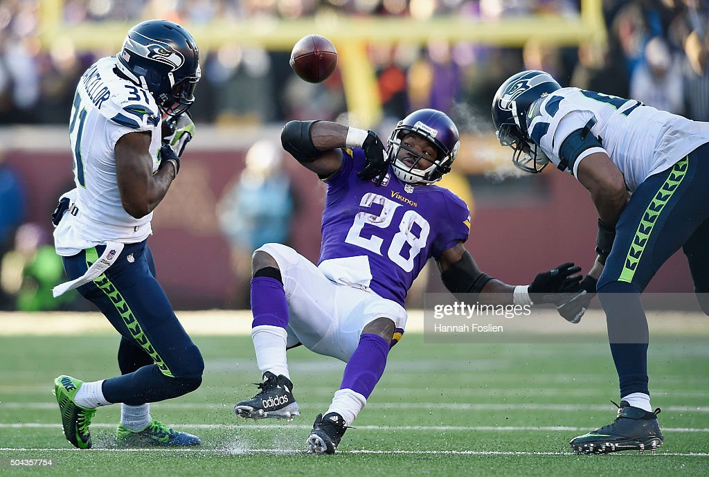 <a gi-track='captionPersonalityLinkClicked' href=/galleries/search?phrase=Adrian+Peterson+-+American+Football+Player+-+Minnesota+Vikings&family=editorial&specificpeople=210807 ng-click='$event.stopPropagation()'>Adrian Peterson</a> #28 of the Minnesota Vikings fumbles the ball in the fourth quarter against the Seattle Seahawks during the NFC Wild Card Playoff game at TCFBank Stadium on January 10, 2016 in Minneapolis, Minnesota.