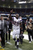 Adrian Peterson of the Minnesota Vikings gestures toward fans after the game against the St Louis Rams at Edward Jones Dome on December 16 2012 in St...