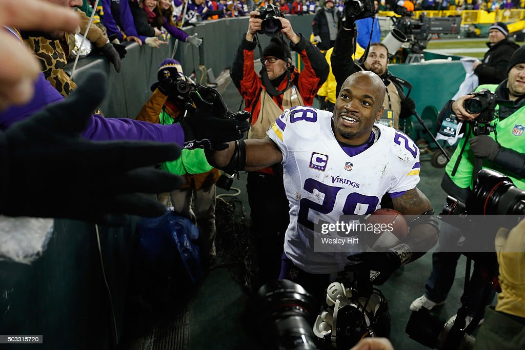 Adrian Peterson of the Minnesota Vikings greets fans after defeating the Green Bay Packers with a score of 20 to 13 at Lambeau Field on January 3...