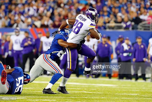 Adrian Peterson of the Minnesota Vikings in action against Ryan Mundy of the New York Giants on October 21 2013 at MetLife Stadium in East Rutherford...
