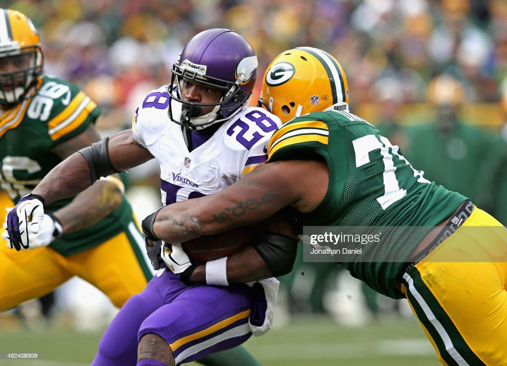 <a gi-track='captionPersonalityLinkClicked' href=/galleries/search?phrase=Adrian+Peterson+-+American+Football+Player+-+Minnesota+Vikings&family=editorial&specificpeople=210807 ng-click='$event.stopPropagation()'>Adrian Peterson</a> #28 of the Minnesota Vikings is hit by Mike Daniels #76 of the Green Bay Packers at Lambeau Field on November 24, 2013 in Green Bay, Wisconsin. The Vikings tied the Packers 26-26 after overtime.