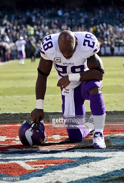 Adrian Peterson of the Minnesota Vikings kneels in the endzone to pray prior to the start of the game against the Oakland Raiders at Oco Coliseum on...