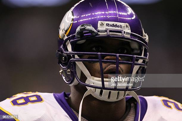 Adrian Peterson of the Minnesota Vikings looks on against the New Orleans Saints during the NFC Championship Game at the Louisiana Superdome on...