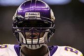 Adrian Peterson of the Minnesota Vikings looks on during warms up against the New Orleans Saints during the NFC Championship Game at the Louisana...