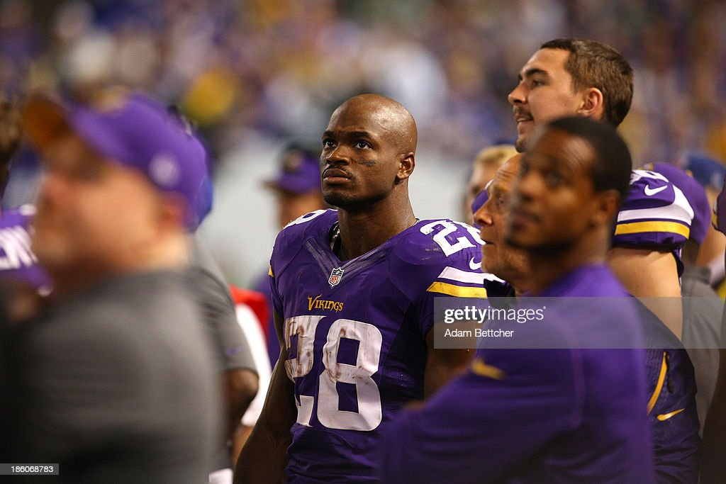 Adrian Peterson #28 of the Minnesota Vikings on the sidelines against the Green Bay Packers on October 27, 2013 at Mall of America Field at the Hubert Humphrey Metrodome in Minneapolis, Minnesota.