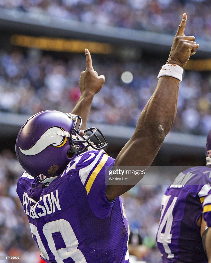 Adrian Peterson #28 of the Minnesota Vikings points to the heavens after scoring a touchdown against the Dallas Cowboys at AT&T Stadium on November 3, 2013 in Arlington, Texas. The Cowboys defeated the Vikings 27-23.