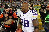 Adrian Peterson of the Minnesota Vikings reacts after defeating the Green Bay Packers with a score of 20 to 13 at Lambeau Field on January 3 2016 in...