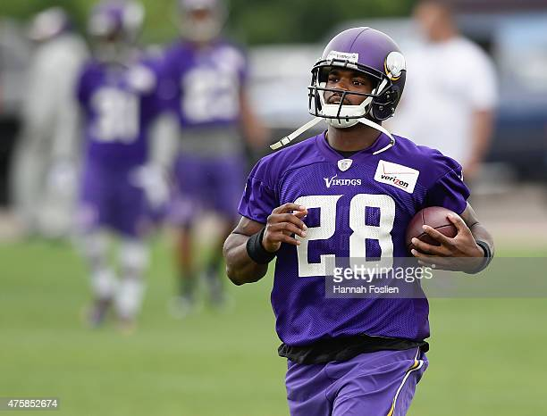 Adrian Peterson of the Minnesota Vikings runs a drill during practice on June 4 2015 at Winter Park in Eden Prairie Minnesota