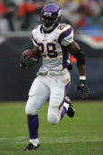 Adrian Peterson of the Minnesota Vikings runs for yardage against the Chicago Bears on October 14 2007 at Soldier Field in Chicago Illinois The...