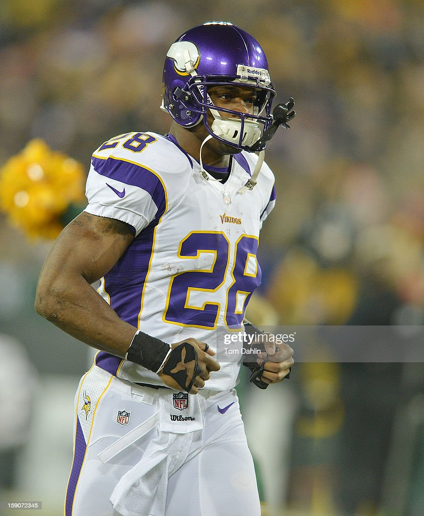 Adrian Peterson #28 of the Minnesota Vikings runs on to the field prior to an NFL game against the Green Bay Packers at Lambeau Field, January 5, 2013 in Green Bay, Wisconsin.