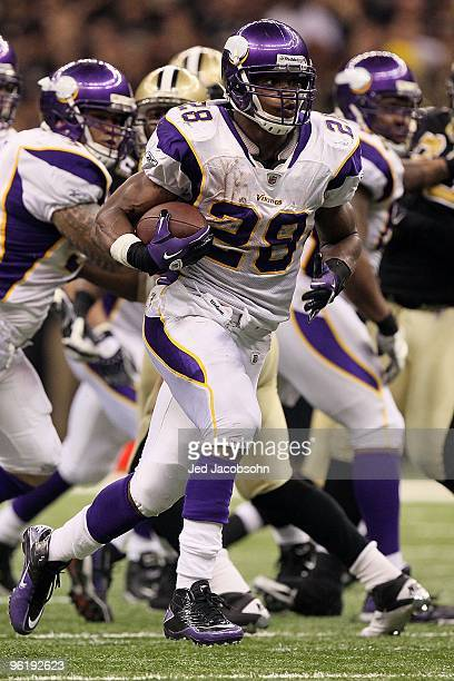 Adrian Peterson of the Minnesota Vikings runs the ball againsnt the New Orleans Saints during the NFC Championship Game at the Louisiana Superdome on...