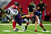 Adrian Peterson of the Minnesota Vikings runs through a tackle by Kroy Biermann of the Atlanta Falcons during the first half at the Georgia Dome on...